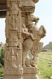 Stone sculptures and bas-reliefs on columns at the entrance to Pushkaran. Pushkarani is a sacred lake on the way to the Vitthala t. Emple in Hampi, Karnataka Royalty Free Stock Photos