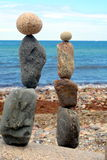 Stone sculptures on beach Stock Photos