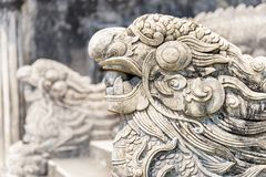 Stone sculptures of dragons at the Imperial City, Hue, Vietnam. Stone sculptures of dragons at the Imperial City in Hue, Vietnam. Hue is a popular tourist stock image