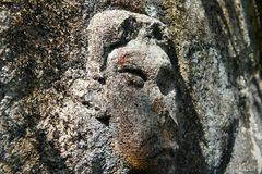 Stone sculptures of the human face. Stock Images