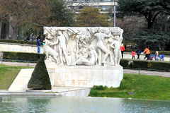 Stone sculptures known as `Jeunesse` and `Joie de Vivre` near water basin,Paris, France,2016. Gorgeous stone sculptures, one known as `Jeunesse` which means Royalty Free Stock Image