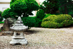 Stone sculpure in japanese garden Royalty Free Stock Images