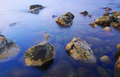 Stone in sea Stock Image