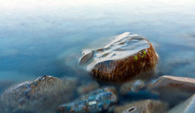 Stone in sea Stock Photography