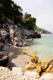 Stone sea beach croatia Stock Photography