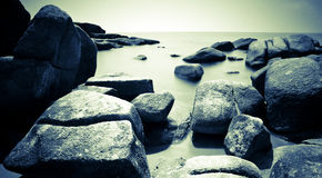Stone and the sea black and white Royalty Free Stock Photography