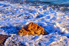 Stone in sea foam Royalty Free Stock Photos
