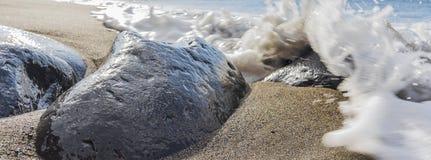 Stone and sea foam Royalty Free Stock Photos