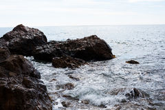 Stone in the sea or ocean. Sharp rock, stones on the sea or ocean beach Royalty Free Stock Photos
