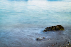Stone in a sea. A stone in a sea. Photo taken using long exposure, with ND filter Stock Photo
