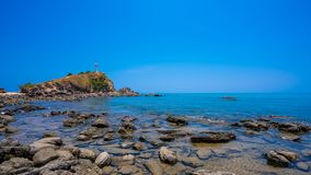 Stone Sea Shore With Lighthouse Royalty Free Stock Photos