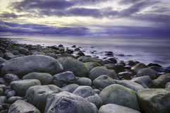 Stone, Sea and Sky. A cold sunset over the stony beach at Seaside, Oregon, USA Stock Photos