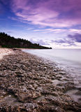Stone Sea Sky. The stony shore of a beach for surfing stock photography