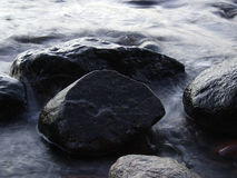 Stone in the sea water Royalty Free Stock Photography