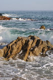 Stone in the sea Stock Photography