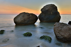 Stone on seashore in evening time Royalty Free Stock Photography