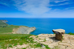 Stone seat above the sea Royalty Free Stock Images