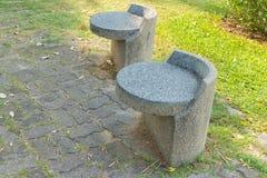 Stone seat in the garden Royalty Free Stock Photos