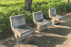 Stone seat in the garden Stock Photography