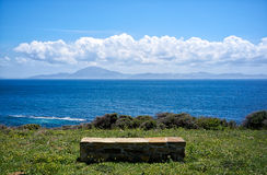 Stone Seat with Views to Africa. Andalusia. Spain. Stone bench with views to Africa. Clear sunny day with clouds in Guadalmesí. Andalusia. Spain Stock Photography