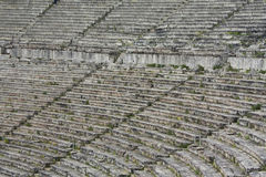 Stone Seats in Greek Ancient Theatre. Close up of stone seats in Greek ancient theatre of Epidauros Royalty Free Stock Photo