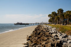 Stone Seawall Toward Empty Pier Stock Photography