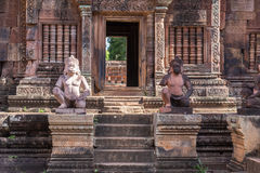 Stone sentinels. Statues near the entrance to the Banteay Srei temple, Angkor,  Cambodia Royalty Free Stock Photo