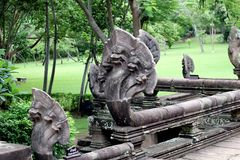 Stone serpent. Detail of five headed snake statue, Prasat Hin Khao temple Stock Photography