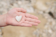 A stone in the shape of a heart, at the beach Stock Photos