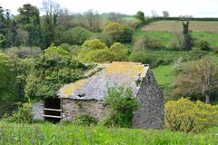 Stone Shed in a Serene Country Sitting. This to was found on one of my many walks around Devon England.  A stone barn out in the middle of nowhere just waiting Royalty Free Stock Photo