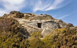 Stone shelter built into rock in the mountains of Corsica Stock Image