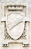 Stone shield. Close-up of a marble carved shield(blazon Royalty Free Stock Images