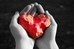 Stone shining red heart in hand Royalty Free Stock Photo