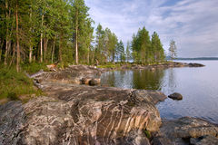 Stone shore of Lake Karelian Stock Photo