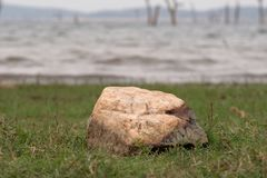 Stone on the shore of the lake. Royalty Free Stock Image