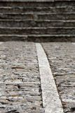 Stone sidewalk with stairs, blurred Stock Images
