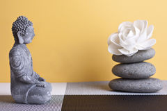 Stone sitting buddha and frankincense Stock Photo