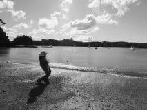 Stone skimming Royalty Free Stock Images