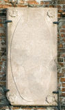Stone slab. An old stone slab mounted on a brick wall with space for text stock images