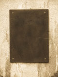 Stone slab. On dirty wall royalty free stock image