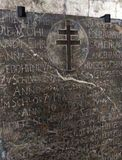 Stone slab with a cross and inscriptions. Background texture Stock Photos