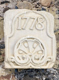 Stone slab engraved with the year 1778. In the monastery of Poblet Stock Photos