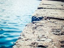 Stone slabs near the water Royalty Free Stock Image