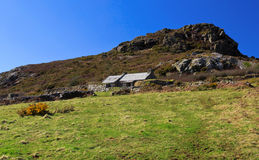 Stone and Slate cottage below Garn Fawr, ancient hill fort. Strumble Head, Pembrokeshire Royalty Free Stock Images