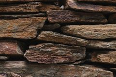 Stone slate wall texture, architecture design with rocks Stock Photo