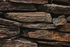 Stone slate wall texture, architecture design with rocks Stock Image