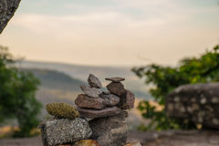Stone small several pieces staked nicely on the mountain. On the background mountain in jungle, Thailand, Stone small background Royalty Free Stock Photo