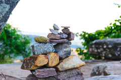 Stone small several pieces staked nicely on the mountain. On the background mountain in jungle, Thailand, Stone small background Stock Photos