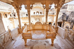 Stone sofa carved in gazebo of the 17th century palace Stock Photos
