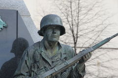 Stone Soldier. Statue of rifleman peering ahead with a determined expression Stock Image